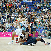 10 August 2012: Argentina Luis Scola vies for the loose ball with Kobe Bryant during 109-80 Team USA victory over Team Argentina, during the men's basketball semi-finals, at the North Greenwich Arena, in London, Great Britain.