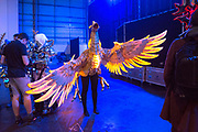 UNITED KINGDOM, London: 25 May 2019 <br /> A cosplay competitor dressed as a Firebird Mount from Final Fantasy XIV consisting of LED lights and recycled materials waits in line backstage before competing in the Championships of Cosplay during the MCM London Comic Con. The three day comic convention is being held at London ExCeL from Fri 24th - Sun 26th of May.