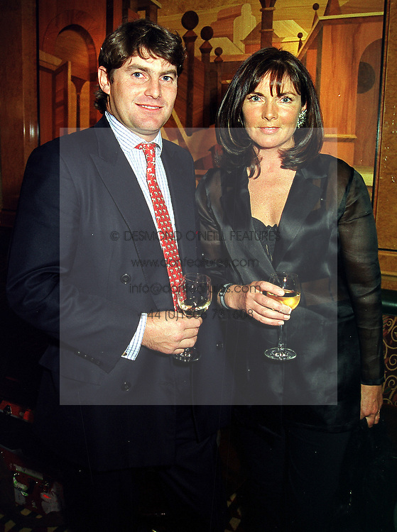 Former race horse trainer MR CHARLIE BROOKS and his close friend MRS MIRIAM FRANCOME, at a party in London on 6th October 1999.MXG 1
