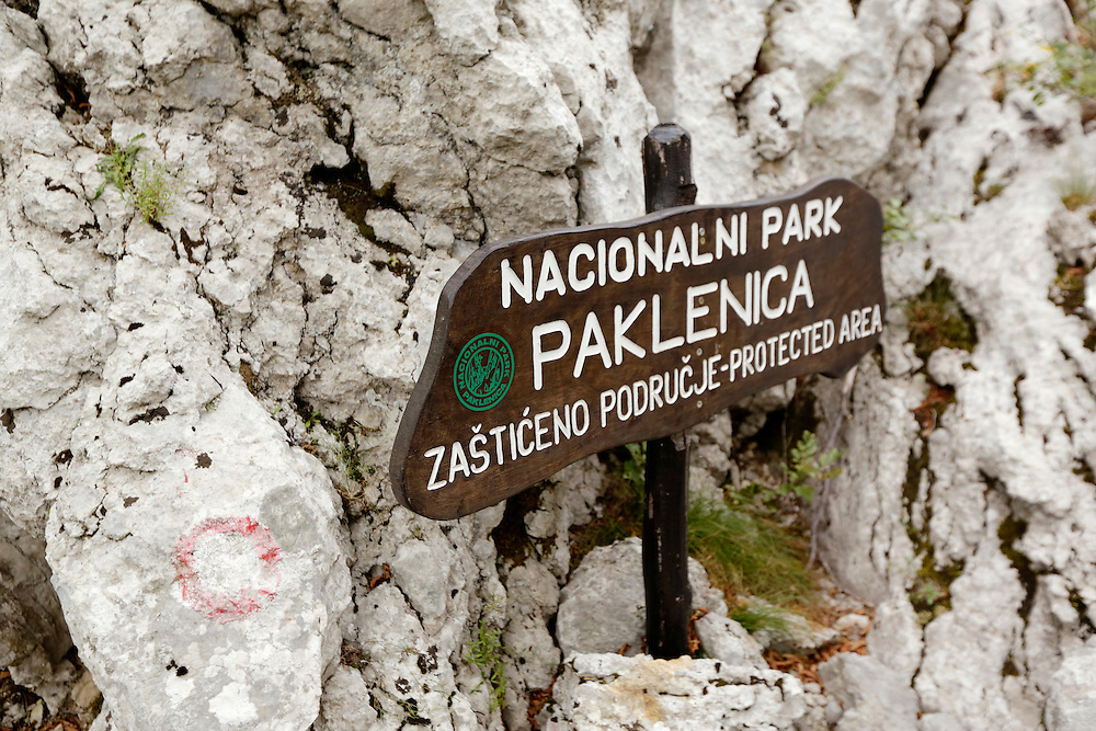 Trail sign for Paklenica National Park, Croatia.