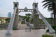 Singapore, Singapore - August 05, 2008: Historic Cavenagh Bridge over the Singapore River in Singapore.
