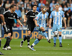 Leon Best of Coventry City  takes on Frank Lampard of Chelsea during the FA Cup Sponsored by E.ON 6th round match between Coventry City and Chelsea at the Ricoh Arena on March 7, 2009