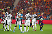 Referee Cüneyt Çakır from Turkey shows a yellow to Arturo Vidal of Juventus during the Champions League Final between Juventus FC and FC Barcelona at the Olympiastadion, Berlin, Germany on 6 June 2015. Photo by Phil Duncan.