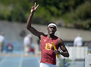 Rai Benjamin celebrates after running the anchor leg on the Southern California 4 x 400m relay that won in 3:06.86 during a collegiate dual meet against UCLA at Drake Stadium in Los Angeles, Sunday, April 29, 2018.