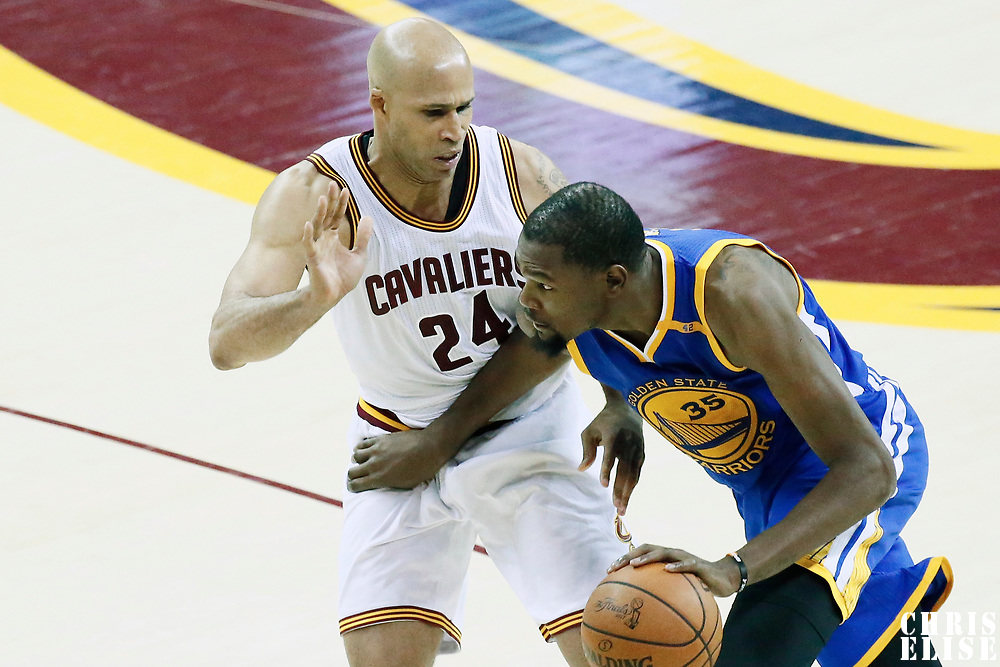 09 June 2017: Golden State Warriors forward Kevin Durant (35) drives past Cleveland Cavaliers forward Richard Jefferson (24) during the Cleveland Cavaliers 137-11 victory over the Golden State Warriors, in game 4 of the 2017 NBA Finals, at  the Quicken Loans Arena, Cleveland, Ohio, USA.