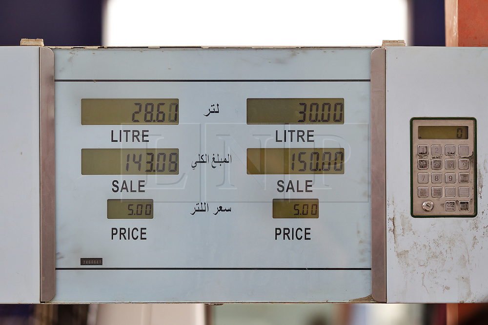 © Licensed to London News Pictures. 26/06/2014. Sulaimaniyah, Iraq. A petrol pump displays the 30 litre ration permitted for drivers in Northern Iraq at a petrol station in Sulaimaniyah, Iraqi-Kurdistan. Despite being an oil-rich country Iraq's main oil refinery at Baiji is now the hands of ISIS insurgents cutting much of the fuel to the rest of the country. Petrol rationing has come in to force across northern Iraq with huge queues that mean many drivers wait in line for hours, sometimes overnight, just to receive their allowance of 30 litres. The shortage has also seen a huge increase in fuel prices with a litre of petrol rising 150% from 500 Iraqi Dinars to 1500 Iraqi Dinars. Photo credit: Matt Cetti-Roberts/LNP