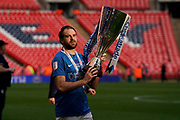Brett Pitman of Portsmouth carries the trophy out during the EFL Trophy Final match between Portsmouth and Sunderland at Wembley Stadium, London, England on 31 March 2019.