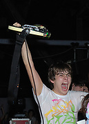 James Righton from the Klaxons, holding a guitar up on stage, Klaxons gig, February 2007