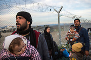 March 5, 2016 - Idomeni, Greece:  Refugees wait for hours at the  Idomeni border crossing in Greece in the  hope to cross to Macedonia that day. . 12,000 refugees are stuck here after Macedonia closed the border. New arrivals come in every day, making living conditions more and more difficult. (Steven Wassenaar/Polaris)