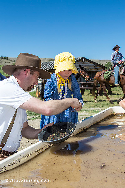 Family panning for gold at Bannack Days in Bannack State Park, Montana, USA model released