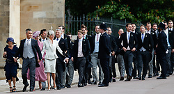 Robbie Williams (second left) arrives with his wife Ayda Field and other guests to attend the wedding for the wedding of Princess Eugenie to Jack Brooksbank at St George's Chapel in Windsor Castle.