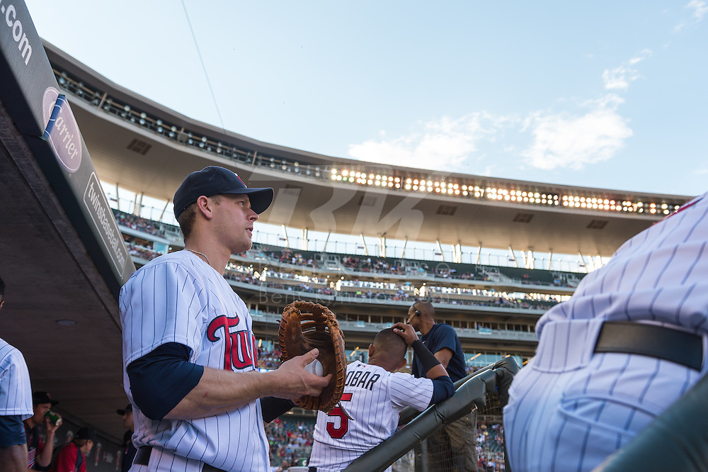 Justin Morneau #33 of the Minnesota Twins looks on from the steps of the dugout during a game against the Kansas City Royals on June 27, 2013 at Target Field in Minneapolis, Minnesota.  The Twins defeated the Royals 3 to 1.  Photo by Ben Krause
