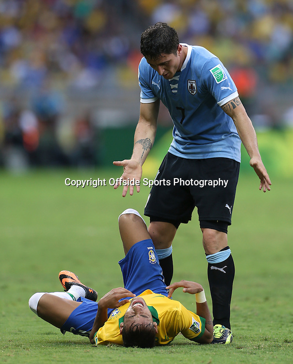 26th June 2013 - FIFA Confederations Cup 2013 (Semi-Final) - Brazil v Uruguay - Cristian Rodriguez of Uruguay stands over the injured Neymar of Brazil - Photo: Simon Stacpoole / Offside.