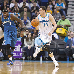 February 1, 2011; New Orleans, LA, USA; New Orleans Hornets power forward Jason Smith (14) drives past Washington Wizards power forward Andray Blatche (7) during the first quarter at the New Orleans Arena.   Mandatory Credit: Derick E. Hingle