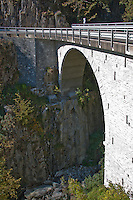 Ticino, Southern Switzerland. Close-up of an arched, stone bridge crossing a gorge in the valle Onsernone.