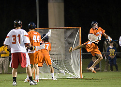 Virginia Goalie Bud Petit (8) leaps to try and make a save against Maryland.  The #3 ranked Virginia Cavaliers defeated the #8 ranked Maryland Terrapins 11-8 in the semi finals of the Men's 2008 Atlantic Coast Conference tournament at the University of Virginia's Klockner Stadium in Charlottesville, VA on April 25, 2008.