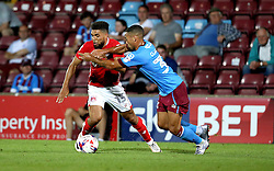 Scott Golbourne of Bristol City goes past Jordan Clarke of Scunthorpe United - Mandatory by-line: Robbie Stephenson/JMP - 23/08/2016 - FOOTBALL - Glanford Park - Scunthorpe, England - Scunthorpe United v Bristol City - EFL Cup second round