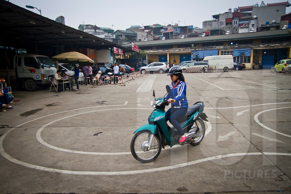 Vietnamese people taking the motorbike driving test in Hanoi, Vietnam, Asia