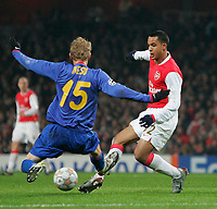 Photo: Tom Dulat/Sportsbeat Images.<br /> <br /> Arsenal v Steaua Bucharest. UEFA Champions League. 12/12/2007.<br /> <br /> Mihai Nesu of Steaua Bucharest and Theo Walcott of Arsenal with the ball.