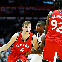 5 October 2016: Toronto Raptors guard Brady Heslip (4) drives past Los Angeles Clippers Xavier Munford on a screen set by Toronto Raptors center Lucas Nogueira (92) during the Los Angeles Clippers 104-98 victory over the Toronto Raptors, at the Staples Center, Los Angeles, California, USA.