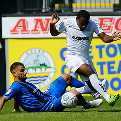 Dover's Anthony Jeffrey rides a tackle by Gillingham's Max Ehmer during the pre-season friendly match between Dover Athletic and Gillingham FC at Crabble Stadium, Kent on 21 July 2018. Gillingham ran out 3 to nothing winners. Photo by Matt Bristow.