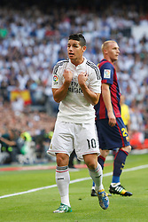 25.10.2014, Estadio Santiago Bernabeu, Madrid, ESP, Primera Division, Real Madrid vs FC Barcelona, 9. Runde, im Bild Real Madrid´s James complains to the referee // during the Spanish Primera Division 9th round match between Real Madrid CF and FC Barcelona at the Estadio Santiago Bernabeu in Madrid, Spain on 2014/10/25. EXPA Pictures © 2014, PhotoCredit: EXPA/ Alterphotos/ Victor Blanco<br /> <br /> *****ATTENTION - OUT of ESP, SUI*****