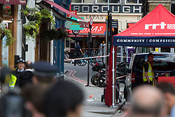 London, June 4th 2017. Forensic investigations continue outside a Tapas restaurant during a massive policing operation in the aftermath of the terror attack on London Bridge and Borough Market on the night of June 3rd which left seven people dead and dozens injured