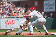 San Francisco Giants second baseman Kelby Tomlinson (37) dives to first base during a pick-off attempt by the Philadelphia Phillies at AT&T Park in San Francisco, California, on August 20, 2017. (Stan Olszewski/Special to S.F. Examiner)