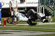 OAKLAND, CA - DECEMBER 19:  Tight end Ben Troupe #86 of the Tennessee Titans catches a 7 yard touchdown pass in the 2nd quarter while defended by linebacker Travian Smith #56 of the Oakland Raiders at Network Associates Coliseum on December 19, 2004 in Oakland, California. The Raiders defeated the Titans 40-35. ©Paul Anthony Spinelli *** Local Caption *** Ben Troupe;Travian Smith