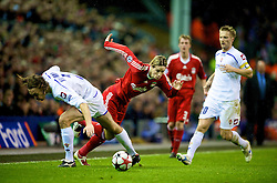 LIVERPOOL, ENGLAND - Wednesday, December 9, 2009: Liverpool's Fernando Torres and AFC Fiorentina's Per Kroldrup during the UEFA Champions League Group E match at Anfield. (Photo by David Rawcliffe/Propaganda)