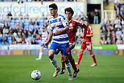 Middlesbrough striker Diego Fabbrini tracks Reading striker Lucaso Piazon during the Sky Bet Championship match between Reading and Middlesbrough at the Madejski Stadium, Reading, England on 3 October 2015. Photo by Alan Franklin.