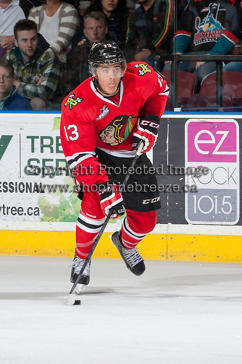 KELOWNA, CANADA - APRIL 19: Keegan Iverson #13 of the Portland Winterhawks skates with the puck against the Kelowna Rockets on April 18, 2014 during Game 2 of the third round of WHL Playoffs at Prospera Place in Kelowna, British Columbia, Canada.   (Photo by Marissa Baecker/Shoot the Breeze)  *** Local Caption *** Keegan Iverson;