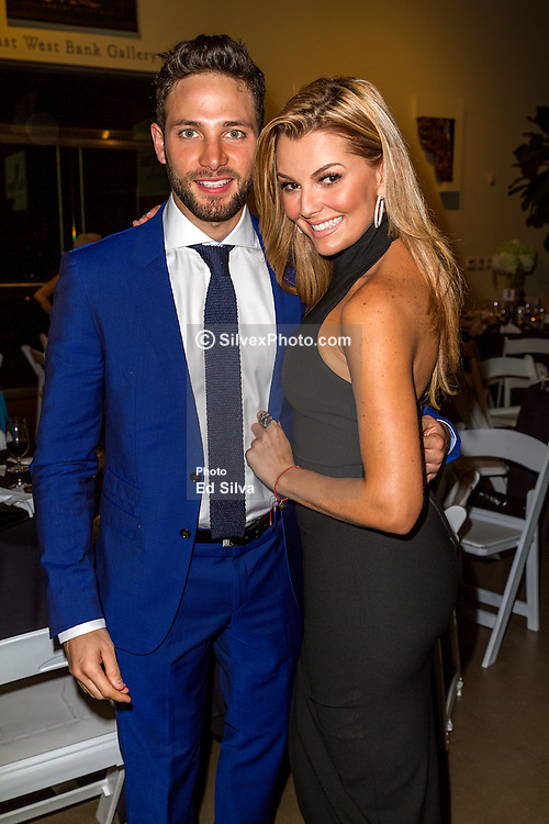 SANTA ANA, CA - OCT 10:  TV actor, singer and model Gabriel Coronel poses with Marjorie de Sousa during ParaTodos Magazine 20th Anniversary Gala at the Bower Museum on 10th of October, 2015 in Santa Ana, California. Byline, credit, TV usage, web usage or linkback must read SILVEXPHOTO.COM. Failure to byline correctly will incur double the agreed fee. Tel: +1 714 504 6870.
