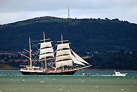 UK-registered Tenacious, a 3-rigged barque departs Belfast, N Ireland, UK, sails down Belfast Lough at the end of the Belfast Maritime Festival in August 2009. In the background is Carnmoney Hill, Co Antrim. 200908163027<br />