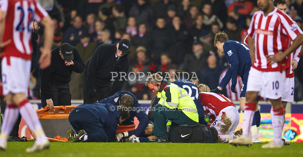 STOKE-ON-TRENT, ENGLAND - Saturday, February 27, 2010: Arsenal's Aaron Ramsey has his broken leg put in a splint as medics treat him on the pitch during the FA Premier League match against Stoke City at the Britannia Stadium. (Photo by David Rawcliffe/Propaganda)