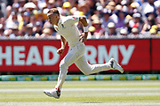 Tom Curran strides into bowl during the Magellan fourth test match between Australia v England at  the Melbourne Cricket Ground, Melbourne, Australia on 26 December 2017. Photo by Mark  Witte.