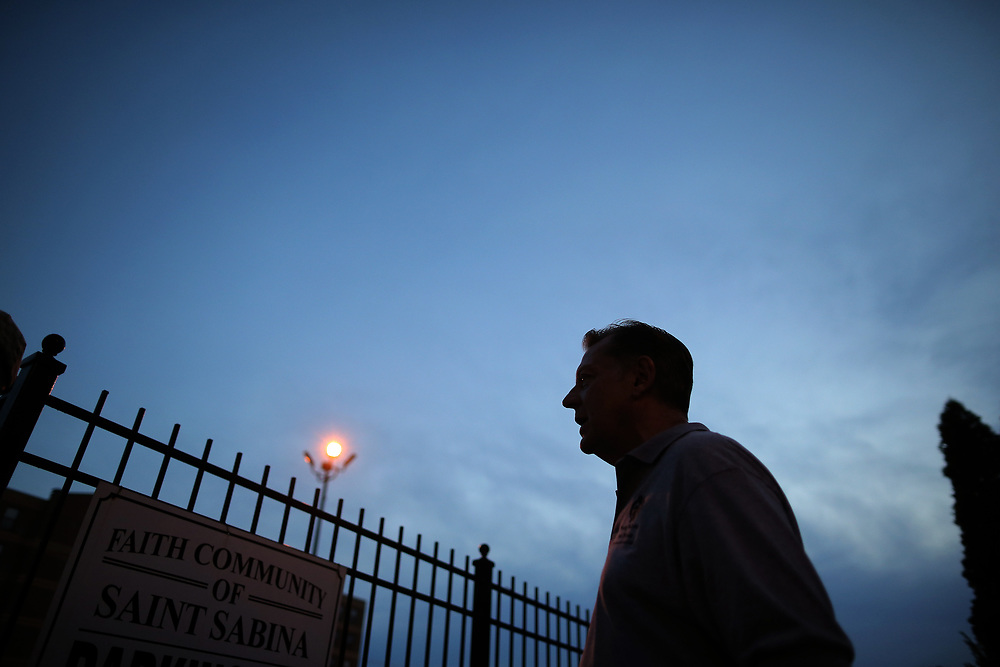 Father Michael Pfleger waits for the start of a weekly night-time peace march through the streets of a South Side neighborhood at Saint Sabina Church in Chicago, Illinois, September 16, 2016.  REUTERS/Jim Young