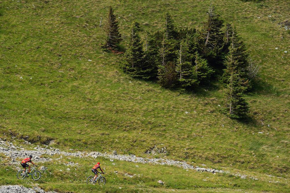 Bicyclists/mountain bikers in a long distance race with goal in Velebit, North Velebit National Park,  Velebit Nature Park, Rewilding Europe rewilding area, Velebit  mountains, Croatia