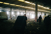 Men inside a warehouse at Napoli NYE Tek, a New Year's Eve party in Naples, Italy, December 2014