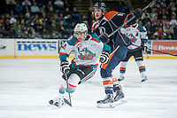 KELOWNA, CANADA - MARCH 14: Cole Ully #21 of Kamloops Blazers checks Dillon Dube #19 of Kelowna Rockets on March 14, 2015 at Prospera Place in Kelowna, British Columbia, Canada.  (Photo by Marissa Baecker/Shoot the Breeze)  *** Local Caption *** Cole Ully; Dillon Dube;