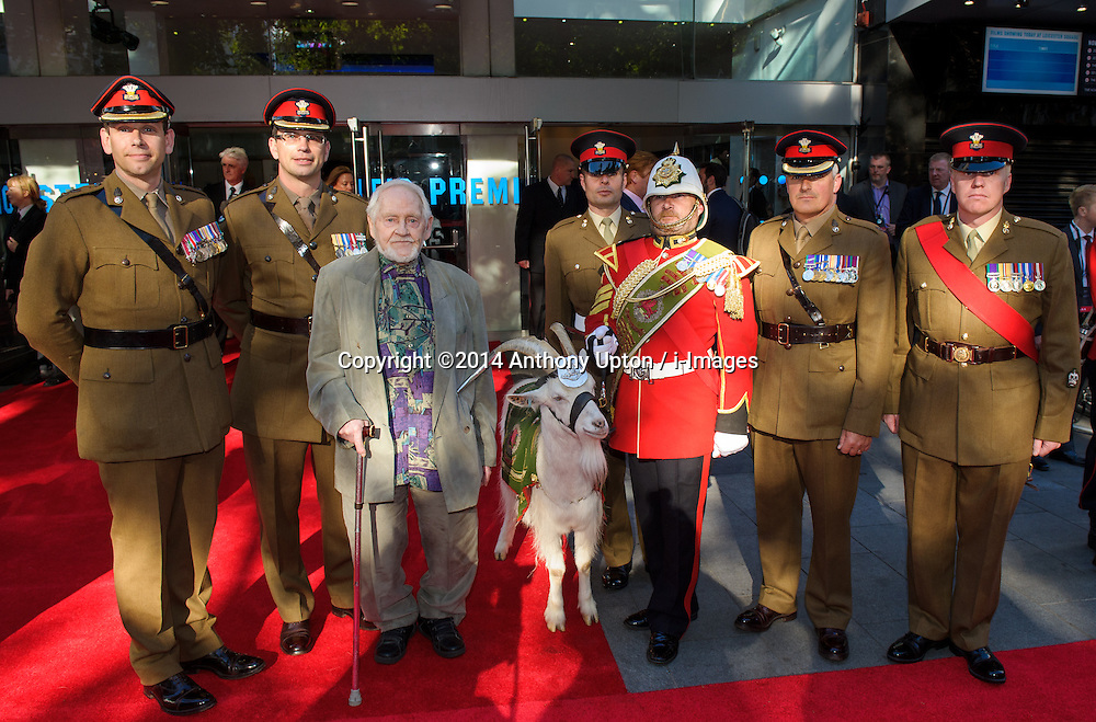 Image ©Licensed to i-Images Picture Agency. 10/06/2014. London, United Kingdom. HRH Prince Harry attends the 50th Anniversary of Zulu premiere. . Picture by Anthony Upton / i-Images<br /> Leicester Square, London, 10 June 2014: Serving members of the Royal Welsh with Denys Graham who played Pvt 716 Jones with the Regimental Mascot 3rd Batt. The Royal Welsh L/Cpl Shenkin and his handler Sgt. Mark Jackson, at a gala screening to celebrate the 50th Anniversary of Zulu where guests were joined by Prince Harry to watch a digitally remastered version of the iconic film. The evening was arranged to raise money for two charities supported by Prince Harry, Walking With The Wounded and Sentebale. <br /> For further info please contact<br /> Emily Conrad-Pickle Captive Minds<br /> Mobile: +44 (0)7799 414 790<br /> emily.conrad-pickles@captiveminds.com