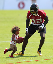 July 27, 2017 - Flowery Branch, GA, USA - Atlanta Falcons wide receiver Mohamed Sanu plays football with his son Mohamed Sanu Jr. after the first day of team practice at training camp on Thursday, July 27, 2017, in Flowery Branch, Ga. (Credit Image: © Curtis Compton/TNS via ZUMA Wire)