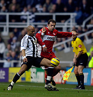 Photo: Jed Wee.<br />Newcastle United v Middlesbrough. The Barclays Premiership. 02/01/2006.<br />Newcastle's Jean Alain Boumsong (L) tries to stop Middlesbrough's Mark Viduka.