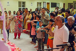 The India Association of the Virgin Islands celebrates the end of Ganesha Chaturthi the ten day Hindu festival to honor the elephant-headed god Ganesha.  During the festival adherents chant and sing songs of worship, present offerings of fruit and flowers,  and whisper prayers and wishes to the god.  India Association of the Virgin Islands Culture Center.  Frenchman's Bay.  St. Thomas.  15 September 2016.  © Aisha-Zakiya Boyd