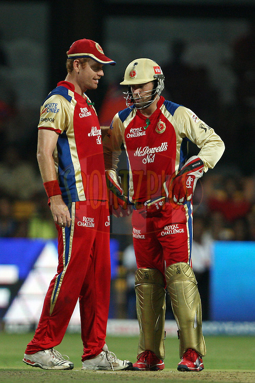 Andrew McDonald congratulates AB de Villiers on the run-out of Azhar Mahmood during match 44 of the the Indian Premier League ( IPL) 2012  between The Royal Challengers Bangalore and the Kings XI Punjab held at the M. Chinnaswamy Stadium, Bengaluru on the 2nd May 2012..Photo by Ron Gaunt/IPL/SPORTZPICS