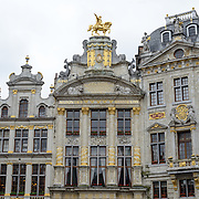 Ornate buildings in the Grand Place, Brussels. Originally the city's central market place, the Grand-Place is now a UNESCO World Heritage site. Ornate buildings line the square, including guildhalls, the Brussels Town Hall, and the Breadhouse, and seven cobbelstone streets feed into it.
