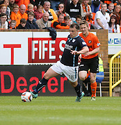 Dundee's Paul McGowan races away from Dundee United's Paul Dixon - Dundee United v Dundee at Tannadice Park in the SPFL Premiership<br /> <br />  - © David Young - www.davidyoungphoto.co.uk - email: davidyoungphoto@gmail.com