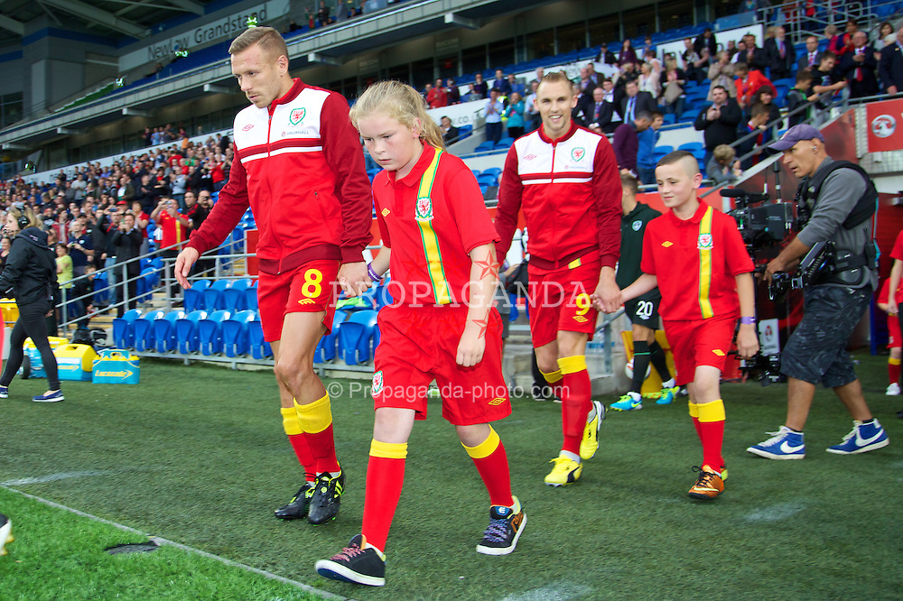 CARDIFF, WALES - Wednesday, August 14, 2013: Wales' Craig Bellamy walks out to face Republic of Ireland during an International Friendly at the Cardiff City Stadium. (Pic by David Rawcliffe/Propaganda)