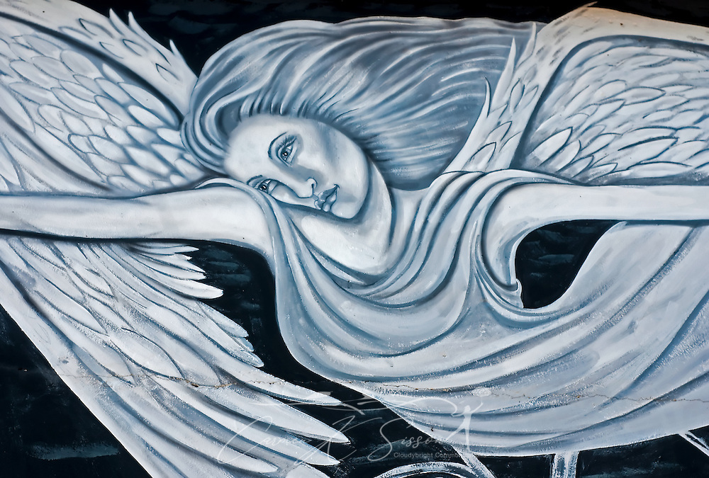 """An intricate painting of angel graces a cinderblock wall May 8, 2011 at Camp Victor in Ocean Springs. Ocean Springs, known as the """"City of Discovery,"""" features whimsical street art throughout the downtown area. Much of the artwork tells the story of the town's history, from its founding by the French in 1699 to the devastation and recovery after Hurricane Katrina. (Photo by Carmen K. Sisson/Cloudybright)"""