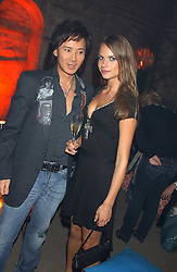 ANDY WONG and NATALIE BOMGREM at a party for De Beers to celebrate the launch of their Rough diamond •Talisman Collectionê held at Shunt Vaults, London Bridge, London SE1 on 28th November 2005.<br /><br />NON EXCLUSIVE - WORLD RIGHTS